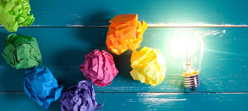 crumpled up colored pieces of paper