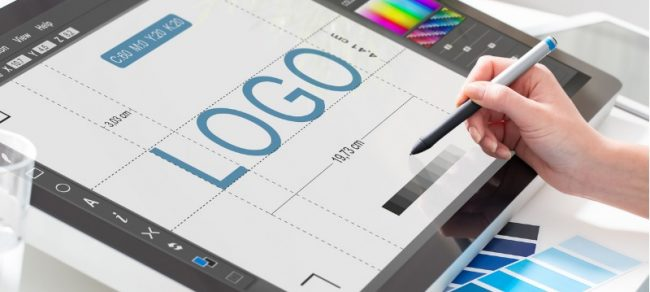 woman designing a logo on a tablet