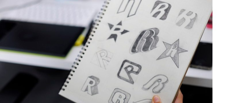 sketched letter R on notepad