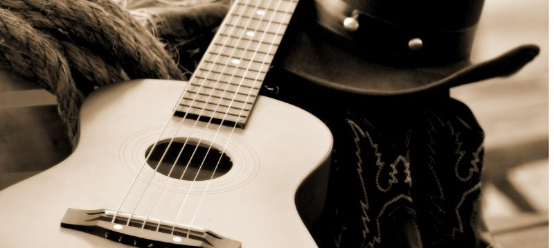 sepia toned image of accoustic guitar