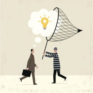 Man in prison uniform with net catching a lightbulb idea from another men in a business suit