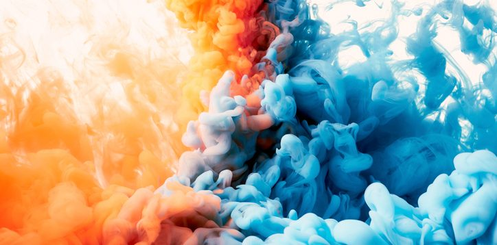 orange and blue ink colliding