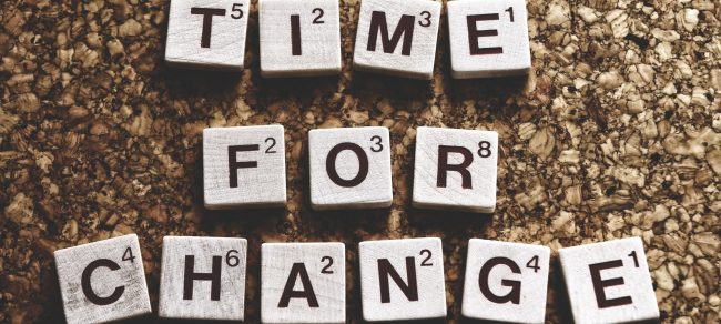 """Time for Change"" written in Scrabble letters"