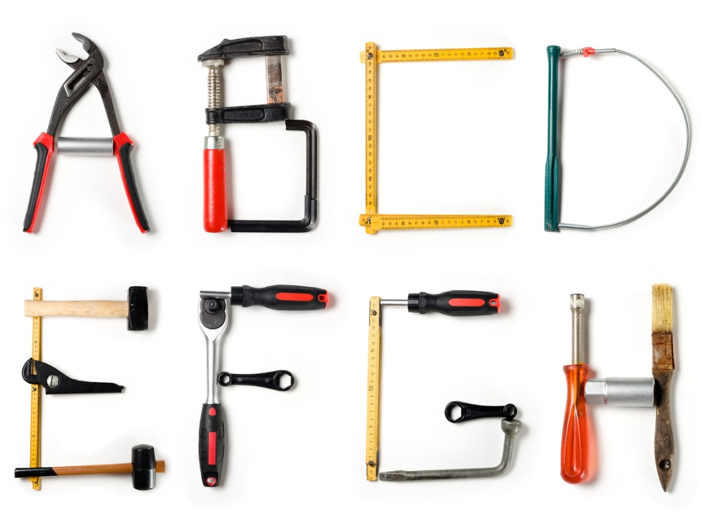 Various home improvement tools in the shape of the alphabet