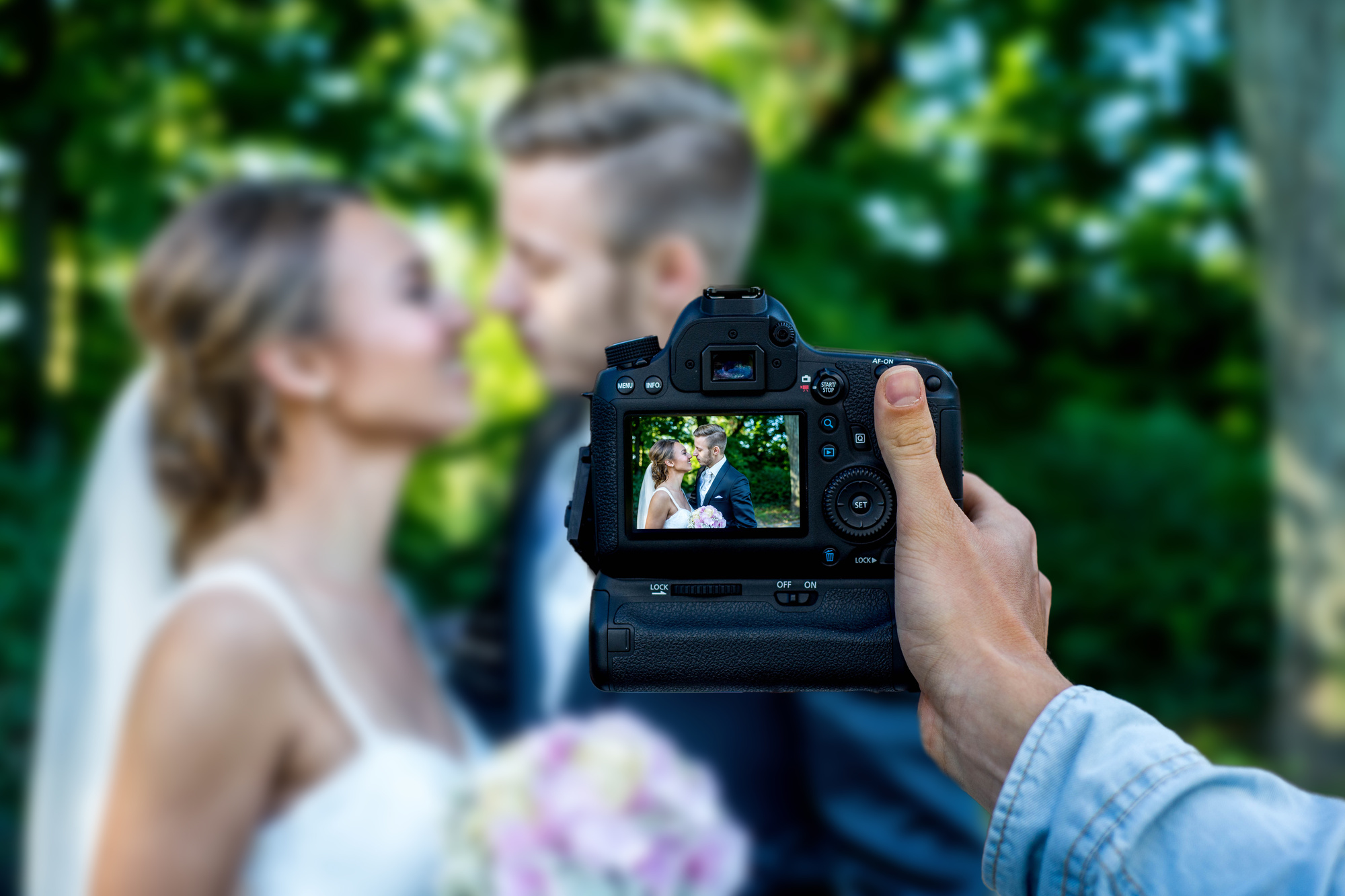 photographer taking picture of married couple